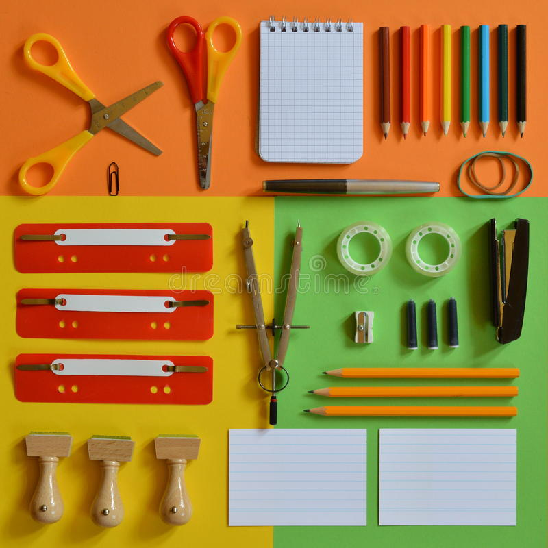 School supplies on colorful paperboard as square stock photo