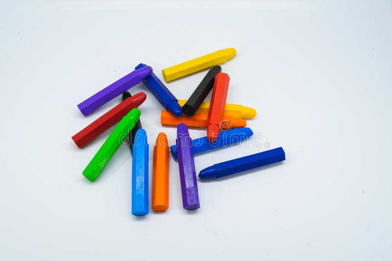 School supplies, colourful crayons stationery on white background royalty free stock photos