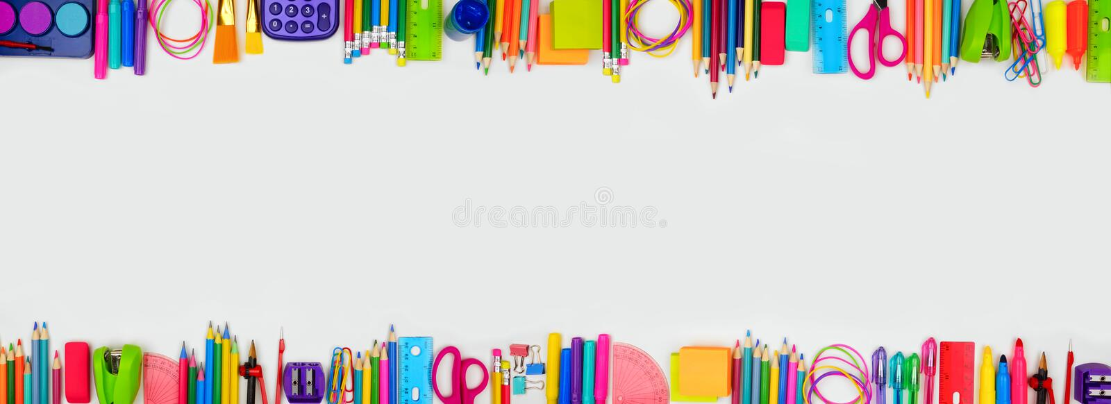 School supplies double border banner, top view on a white background with copy space. Back to school. stock photos