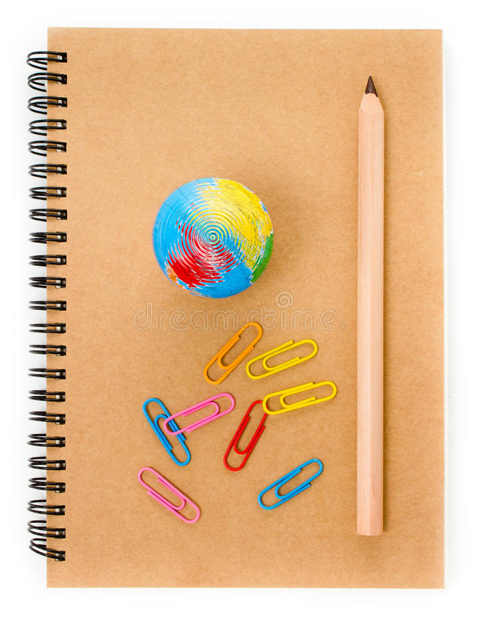 School supplies with Globe, clip and notebook on white backgrou stock photo