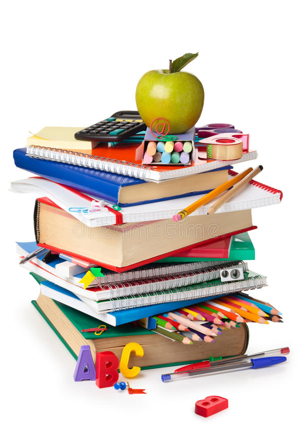 School supplies. School supplies and green apple isolated on white background royalty free stock image