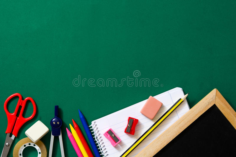 School supplies on green background. Back to school concept. stock photography