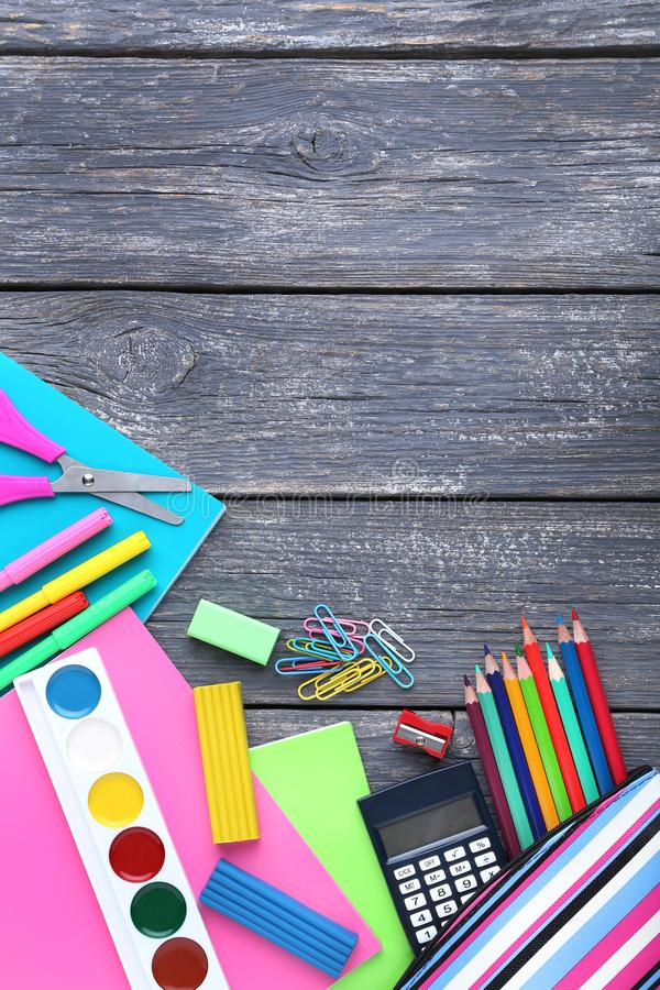 School supplies. On grey wooden table royalty free stock photos