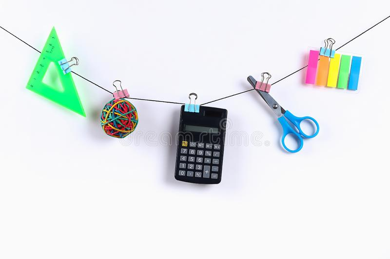 School supplies hang on rope. School supplies on white background. Back to school concept stock images