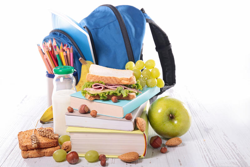 School supplies and healthy food stock photography