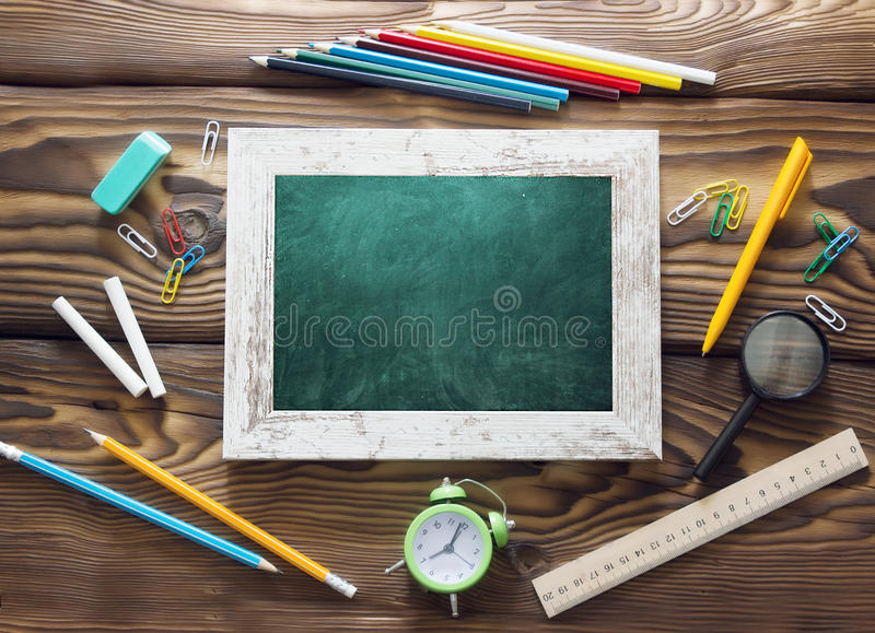 School supplies objests back to school blackboard on wooden back royalty free stock photo
