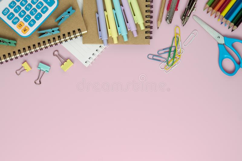 School supplies and office stationary on pink color background t royalty free stock images