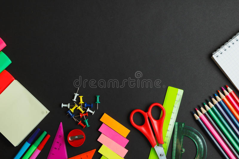 School supplies side border on a chalkboard background royalty free stock photography