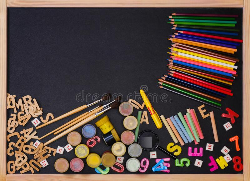 School supplies side border on a chalkboard royalty free stock image