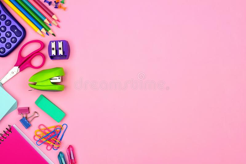 School supplies side border over a pastel pink background stock image