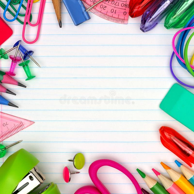 School supplies square frame on lined paper background stock images