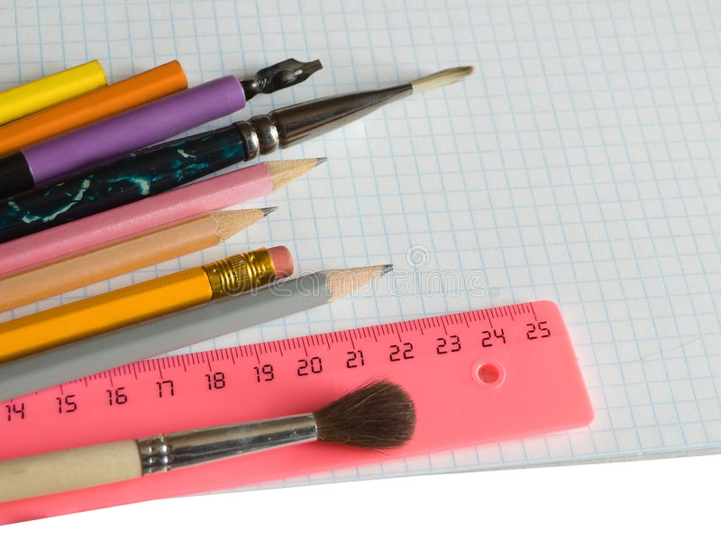 School supplies on squared sheet. Of a copybook royalty free stock photo