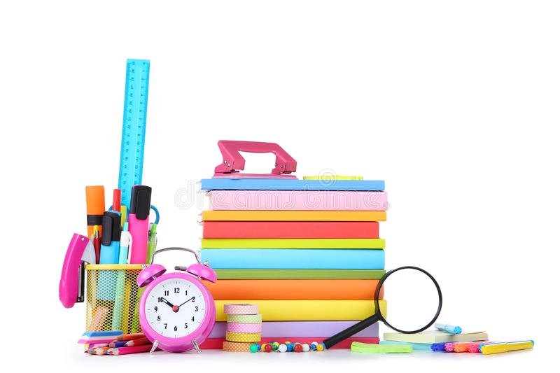 School supplies with stack of books. And alarm clock on white background royalty free stock image