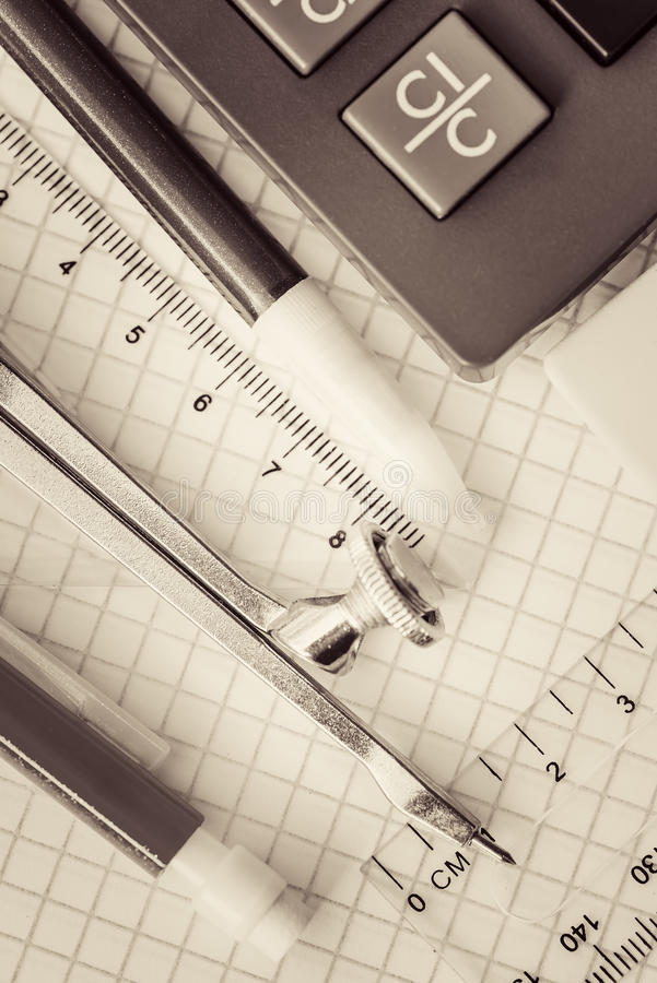 School supplies toned in sepia royalty free stock photography