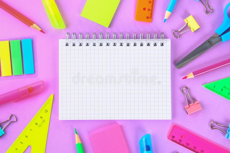 School supplies on violet background ready for your design. Flat lay. Top view. Copy space. School supplies on violet background ready for your design. Flat lay stock images