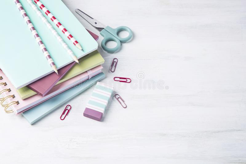 School supplies on a wooden background. With copy space royalty free stock photos