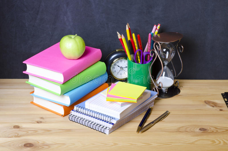 School supplies on wooden stock photography
