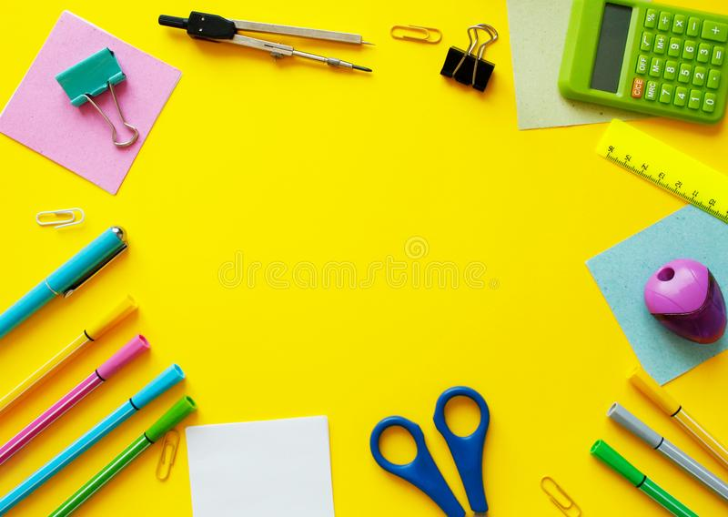 School supplies on yellow background. Back to school concept with space for text. Top view. Copy space. School office supplies. Creative desk with colourful stock photography