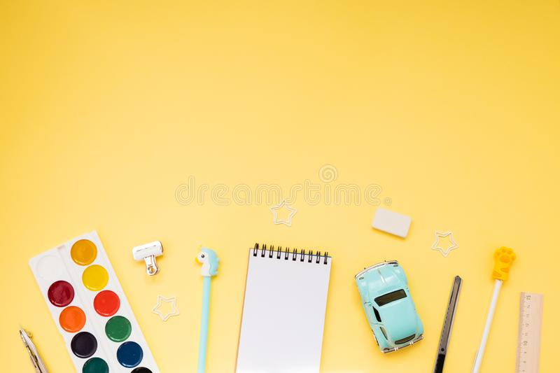School supplies on yellow background. Back to school. Flat lay stock photo