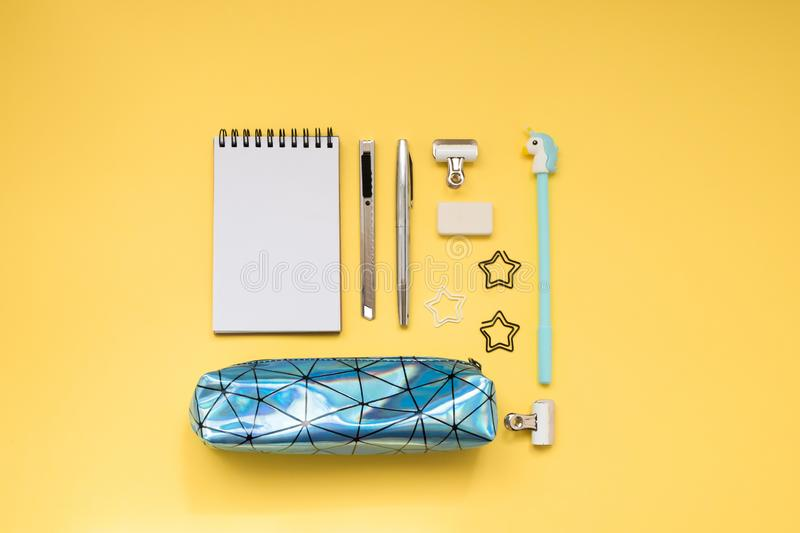 School supplies on yellow background. Back to school. Flat lay stock photography