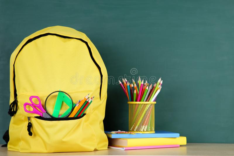 School supplies with backpack royalty free stock photo