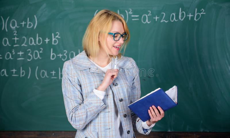 School teacher explain things well and make subject interesting. Effective teaching involve acquiring relevant knowledge. About students. Teacher woman explain royalty free stock photography