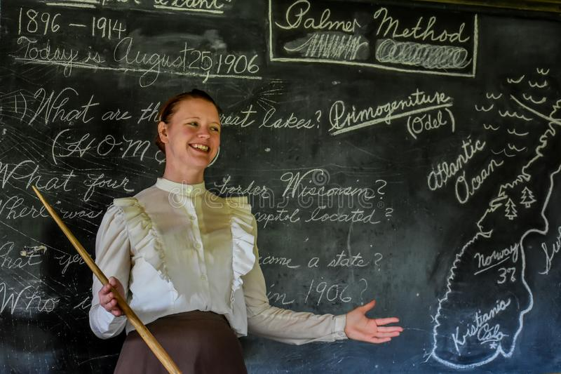 School Teacher in Front of Blackboard royalty free stock photos