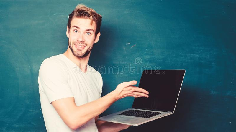 School teacher programming with laptop. Student learn programming language. Programming web development. Handsome man. Use modern technology. Digital technology stock photography