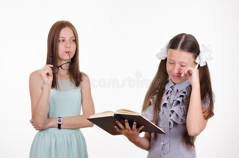 School teacher scolds distressed student stock photo