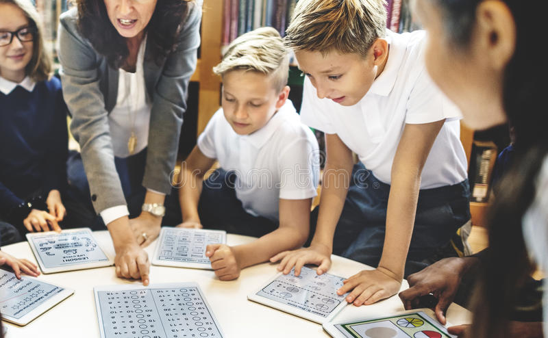 School Teacher Teaching Students Learning Concept.  stock images