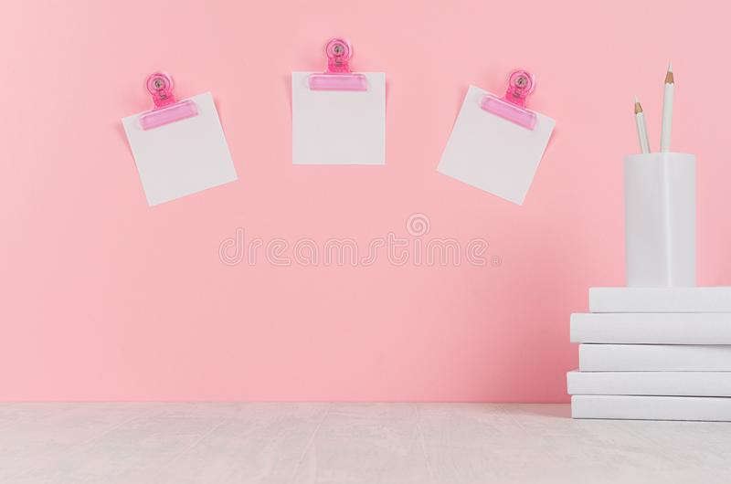 School template - white books, stationery, blank stickers, decorative balloons origami on white desk and soft pink background. royalty free stock images