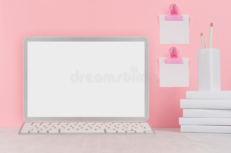 School template - white books, stationery, blank stickers and notebook computer on white desk and soft pink background. stock image