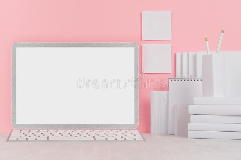 School template - white books, stationery, blank stickers and notebook computer on white desk and soft pink background. royalty free stock photo