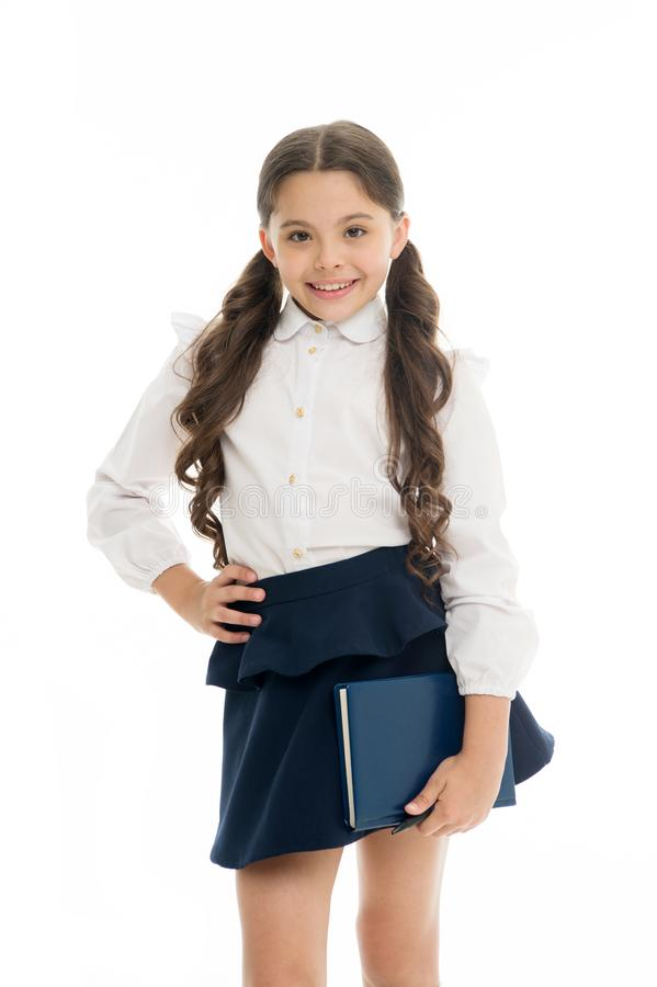 School textbook and stationery concept. Child school uniform smart kid happy hold textbook. Girl happy face carry. Textbook white background. Child girl school royalty free stock image