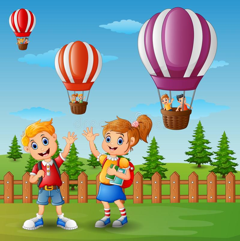 School van een jongen en een meisjes golvende hand buiten de omheining met een hete luchtballon stock illustratie