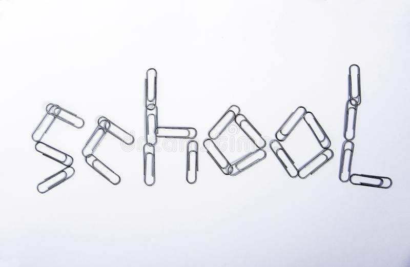 School is a word made from metal paper clips royalty free stock photos