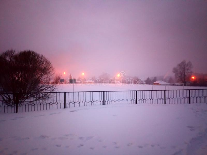 School yard in the winter evening royalty free stock photos