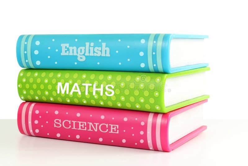 Schoolboeken op witte achtergrond stock foto's
