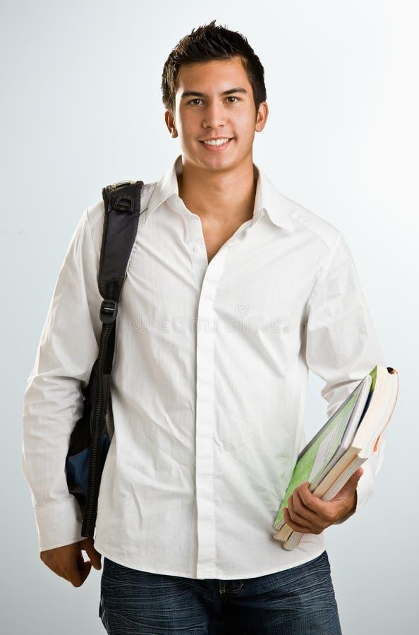 schoolbooks человека backpack стоковые фото