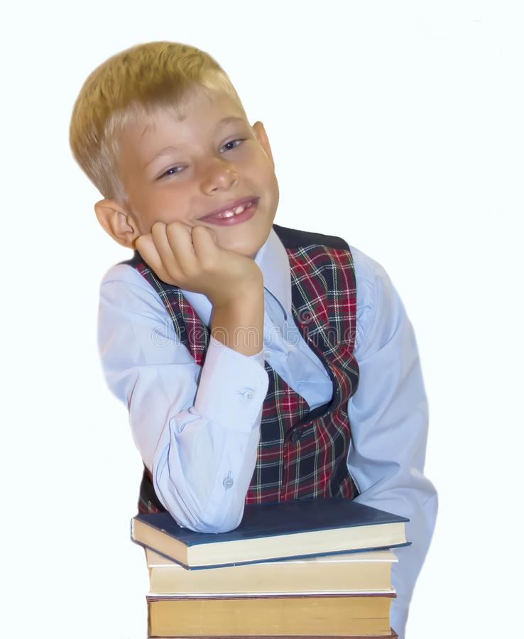 Schoolboy with books on a white background.Isolate stock photography