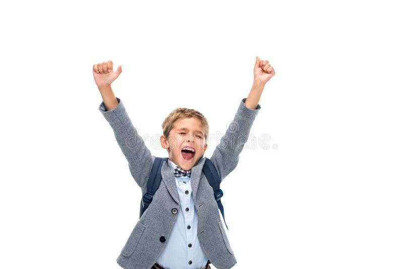 Schoolboy celebrating victory. Happy schoolboy celebrating victory isolated on white royalty free stock photo
