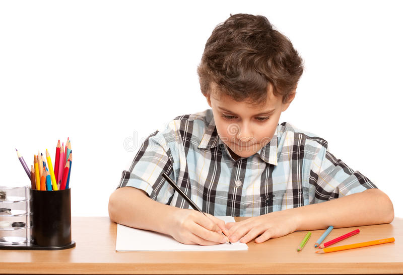 Download Schoolboy doing homework stock photo. Image of test, person - 12807862