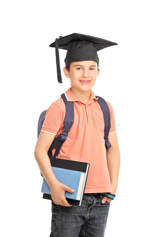 Schoolboy with a graduation hat holding books stock photo