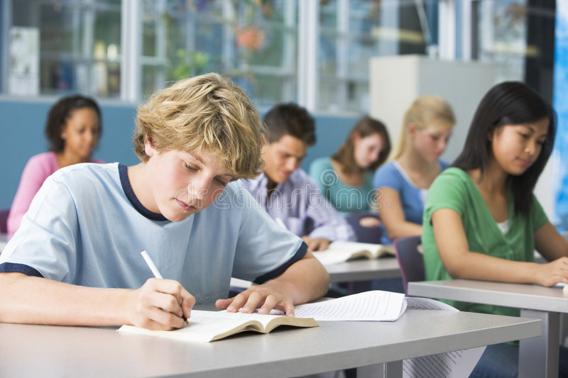 Schoolboy in high school class royalty free stock photo