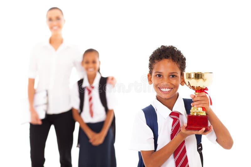 Schoolboy holding trophy stock photo