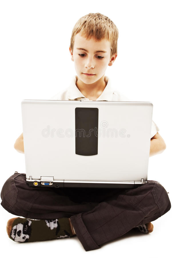 Schoolboy with laptop royalty free stock photography