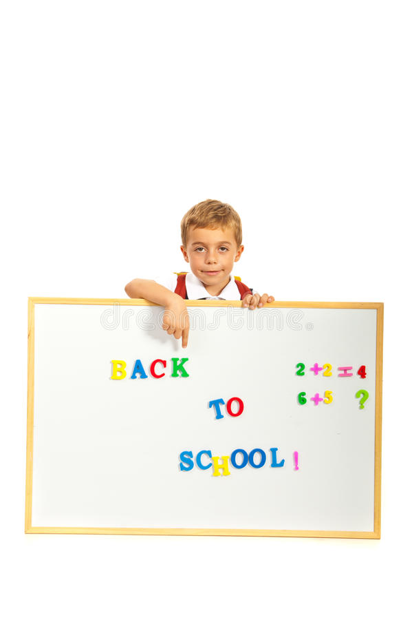 Schoolboy pointing to message stock image