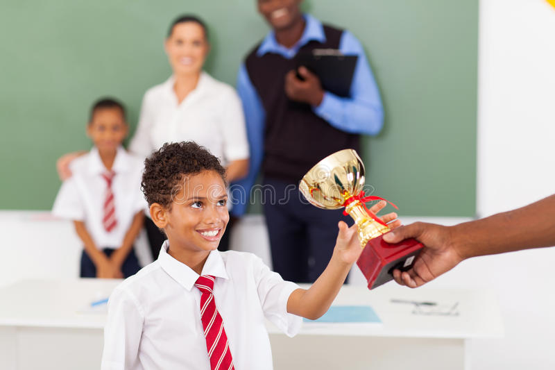 Schoolboy receiving trophy stock photo