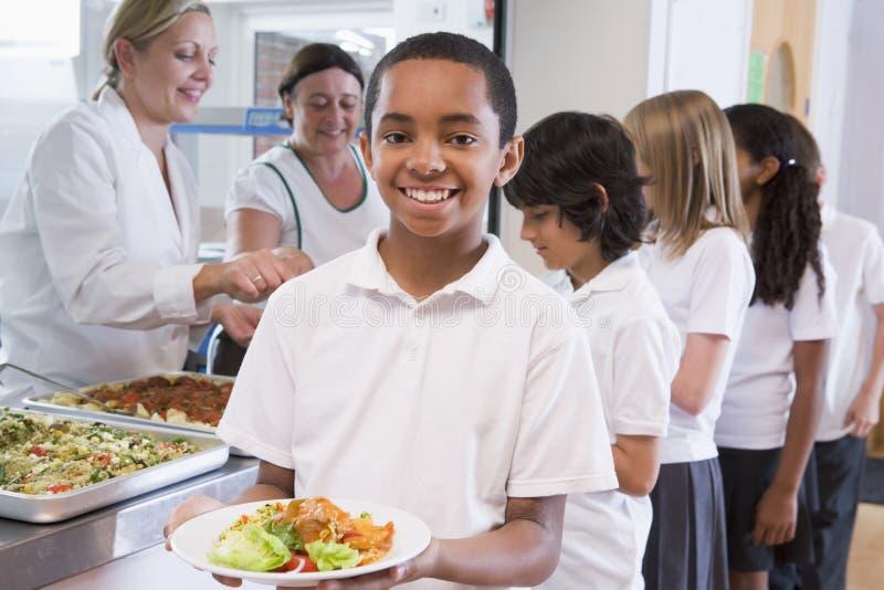 Schoolboy in a school cafeteria stock photos