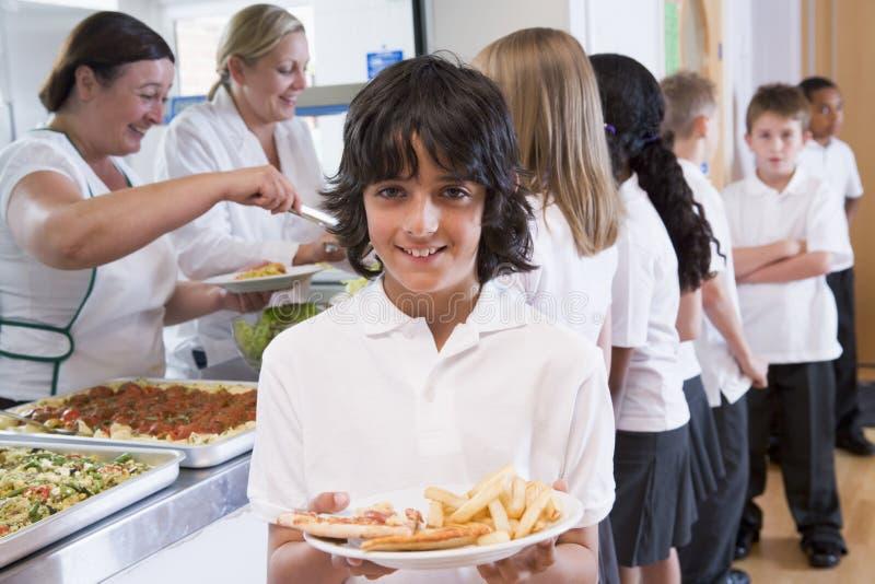 Schoolboy In A School Cafeteria Royalty Free Stock Image